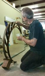 Fine tuning a bell stand.